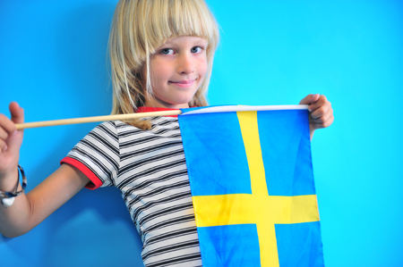 Portrait of sweden boy at the blue wall