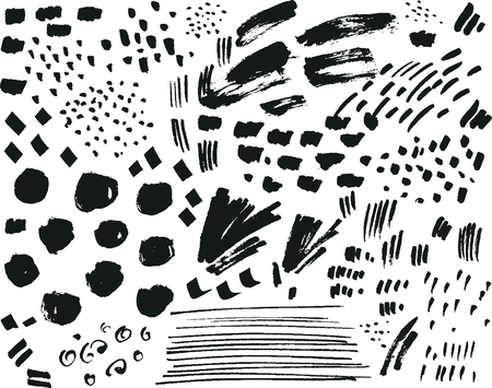 spatters: Collection of black ink brush points, spatters, marks and strokes isolated on white background. Stock Photo