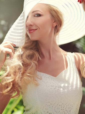 Beautiful woman in white dress and a hat