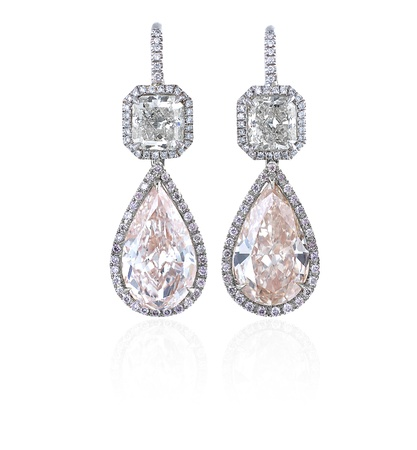 Diamond earrings isolated on white background