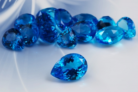 Group of topaz gemstones with artistic background