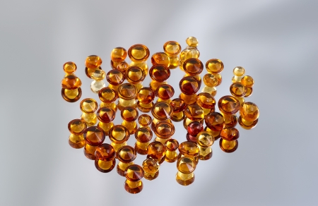 Group of citrine gemstones on mirror  Stock Photo