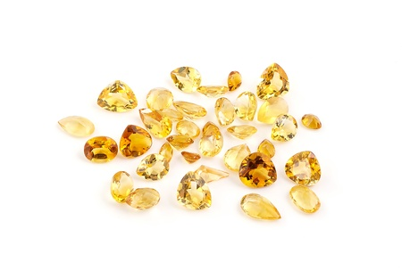 Group of citrine gemstones on white
