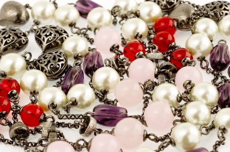 Background of vintage beaded necklace with stones and pearls