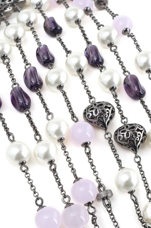 Strings of vintage beaded necklace with stones and pearls isolated on white  Stock Photo