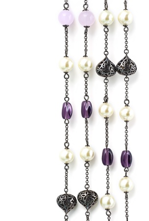 Four vertical strings of vintage beaded necklace with stones and pearls isolated on white  Stock Photo