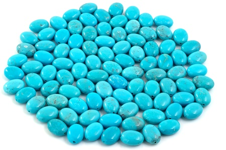 Group of turquoise beads on white  Stock Photo