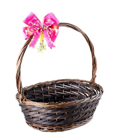 Empty wicker basket with red bow isolated on white background