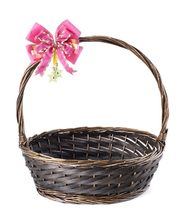 Empty wicker basket with red bow isolated on white background  Stock Photo - 15968099