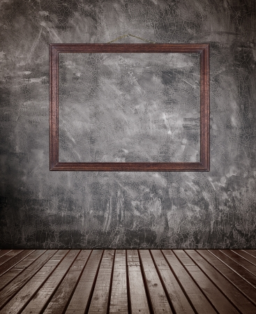 wood abandoned: Old wooden floor room with picture frame hanging on the  ragged concrete wall