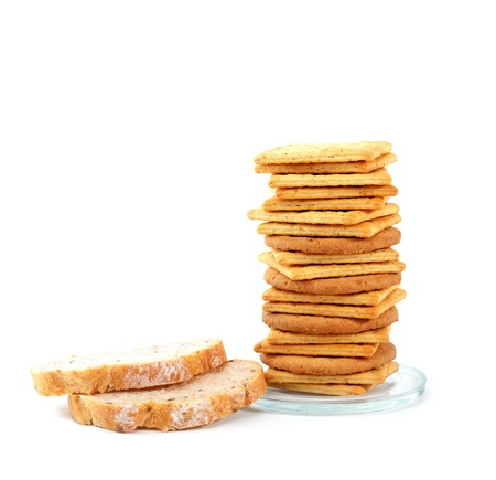 Pile of crackers and bread isolated on white with copy space