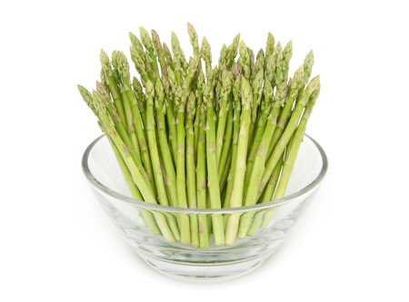 Baby asparagus in the bowl isolated on white background Stock Photo