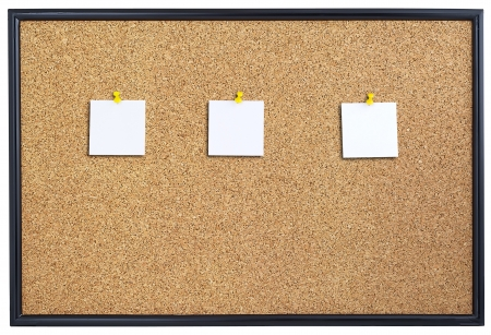Cork board with three pieces of paper pinned