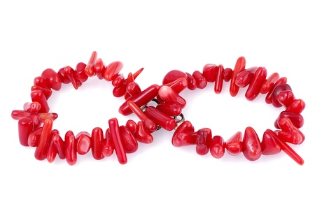Natural coral bracelet laid out as infinity symbol, isolated on white background