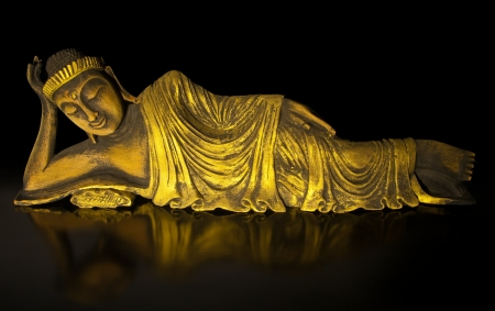 Teak wood lying buddha on black Stock Photo