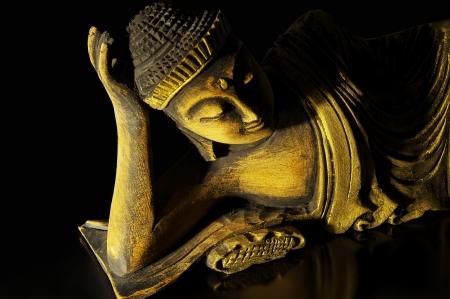 god box: Teak wood lying buddha on black Stock Photo