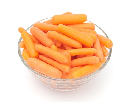Baby carrots in a bowl isolated on white.