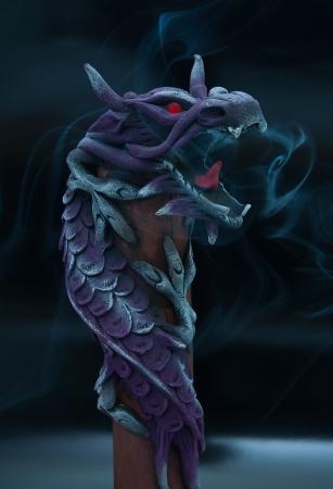 Insence stick inside wooden dragon