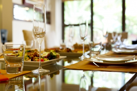 dine: Served table with wine glasses