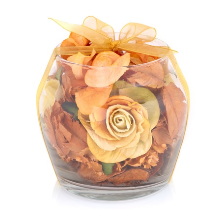 Dry flowers inside transparent glass bowl isolated on white background  Stock Photo