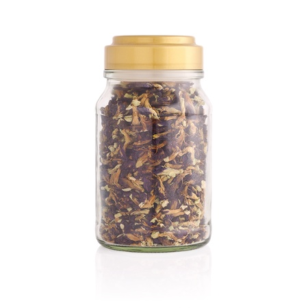 Herbal tea in a jar isolated on white