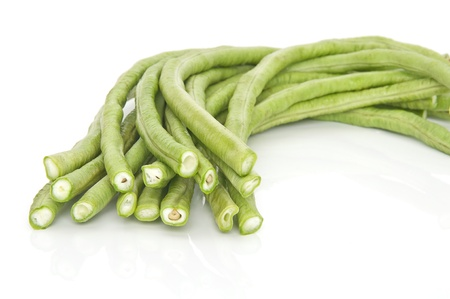 french bean: Long green beans isolated on white.