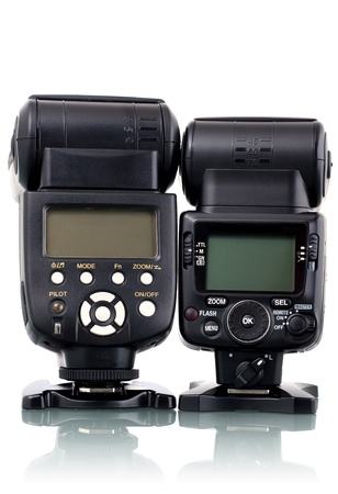 camera flash: Couple of different flash speedlights snading on white, back view. Stock Photo