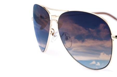 Side view of aviator woman sun glasses with sky reflection isolated on white background.