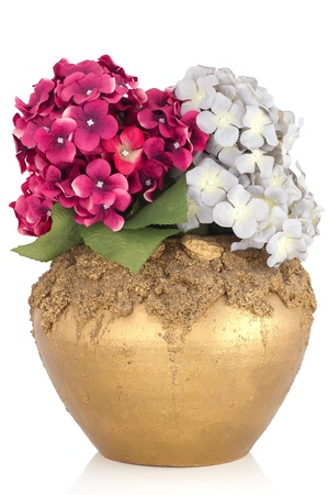 Pottery vase with artificial flowers isolated on white photo