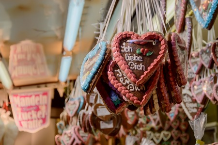 Traditional gingerbread hearts at the Christmas market in Fulda, Germany, Translation - I love you Stock Photo