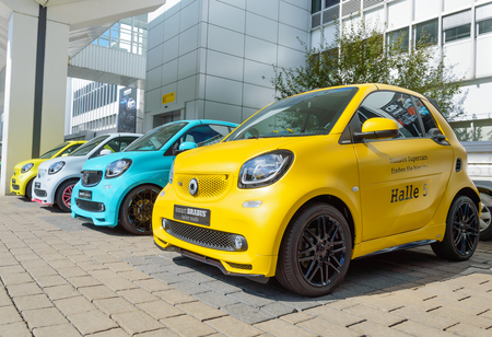 FRANKFURT, GERMANY - SEP 17, 2017: Brabus Ultimate 125 - tuning for Smart Fortwo at IAA Frankfurt Motor Show in yellow, blue and violet