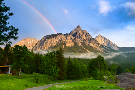 Rainbow over the Ehrwalder Sonnenspitze mountain in the austrian Alps - Ehrwald, Tyrol, Austria.
