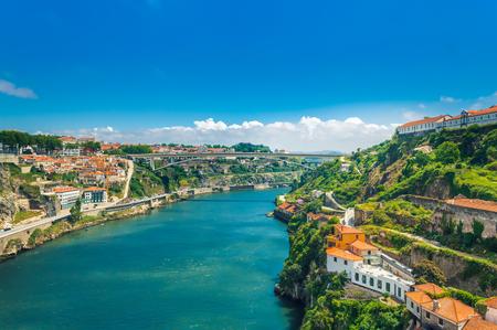 Porto, Portugal: hills of Vila Nova de Gaia with Monastery of Serra do Pilar, wine cellars and Ponte Infante D Henriques bridge over Duoro river