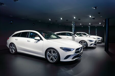 FRANKFURT - SEP 15, 2019: white Mercedes-Benz CLA 200 Shooting Brake cars standing in a row at IAA 2019 International Motor Show, compact luxury car by Mercedes Benz, side view