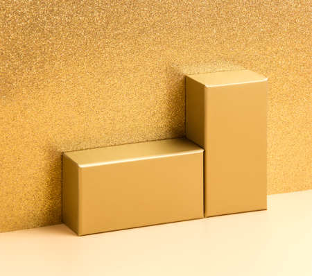 Abstract golden background with podium for product presentation on beige and luxury glitter gold background. Festive holiday design or mock up for package placement, promotion sale or cosmetic display Фото со стока