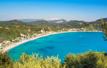 Porto Timoni beach on Corfu island in Greece. Beautiful panoramic view of green mountains, clear sea water, secluded Pirates bay and double stony beach. Famous destination for summer vacation 写真素材