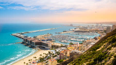Alicante, beach and port with luxury yachts and sailboats from above at sunset. View of beautiful touristic town in Costa Blanca region on Mediterranean sea coast, Spain 写真素材