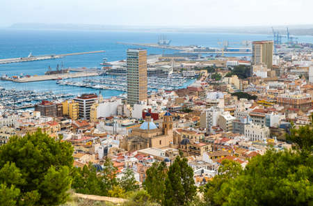 Alicante old town with narrow streets, ancient houses, port with yachts and Cathedral. Historic neighborhood Casco Antiguo Santa Cruz. Costa Blanca region in Spain. 写真素材