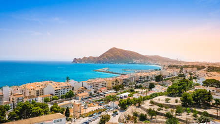 Altea, Spain - beautiful small town with beach, harbour, train and mountains at sunset. Popular Spanish tourist destination in Costa Blanca region on Mediterranean sea
