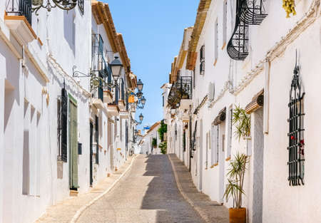 Typical view of Altea old town in Spain. Beautiful village with cobblestoned narrow streets, typical Mediterranean white houses and lanterns, popular tourist destination in Costa Blanca region