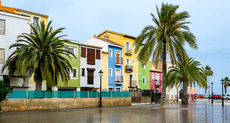 Villajoyosa village, Spain - beautiful colorful houses and palm trees after rain. Popular Spanish tourist destination in Costa Blanca region on Mediterranean sea 写真素材