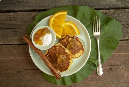 corn pancakes with sour cream and rhubarb sauce. Reklamní fotografie