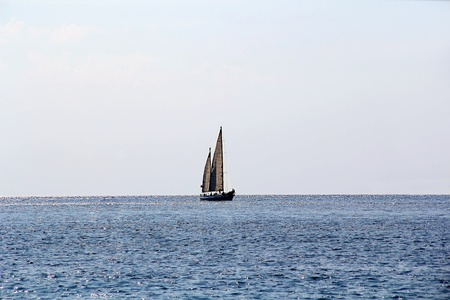 Landscape with calm sea and beautiful sailboat Stock Photo