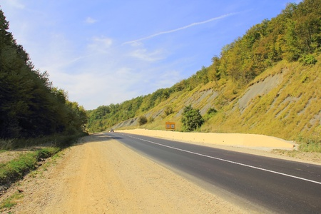 Summer beautiful landscape with Caucasus mountains and road