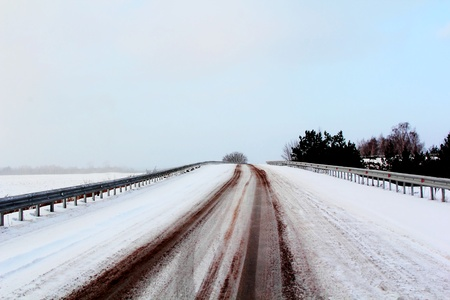 Image of winter road and cloudy sky