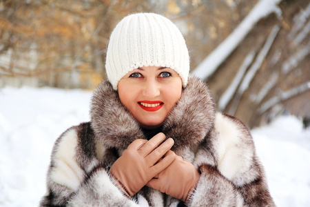 Portrait of beautiful young woman in winter coat photo