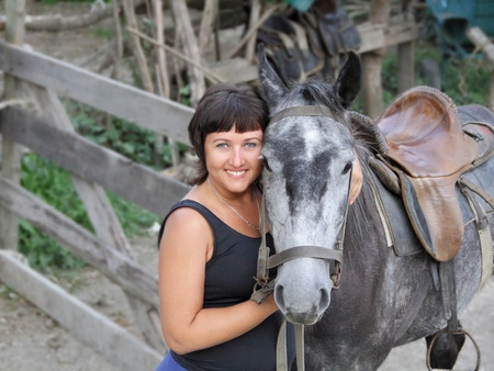 Portrait happy smiling woman with grey horse Stock Photo - 12929659
