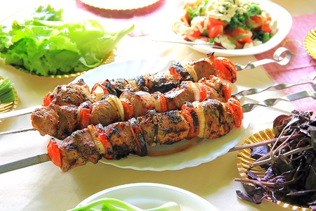 Image with fried meat, tomato and onion photo