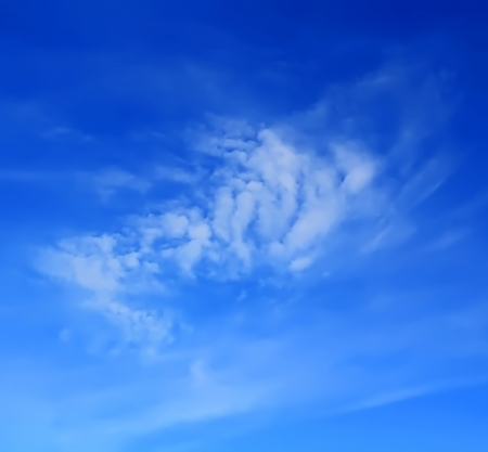 Image of the summer fluffy blue sky