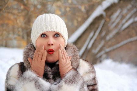 Portrait of surprised woman in winter coat photo